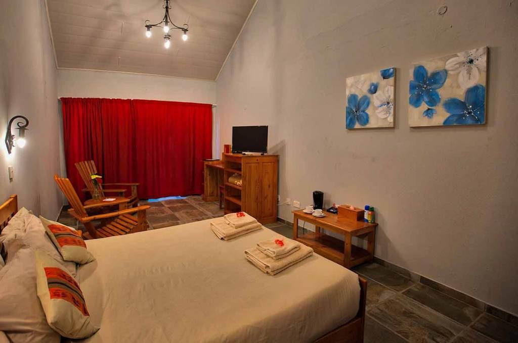 Heritage room interior, Island Safari Lodge