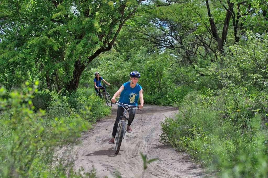 Cycling along the trail at Island Safari Lodge